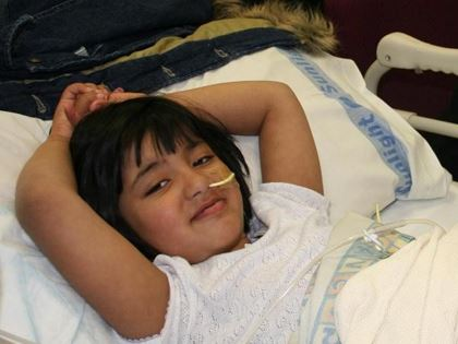 young girl with nasogastric tube